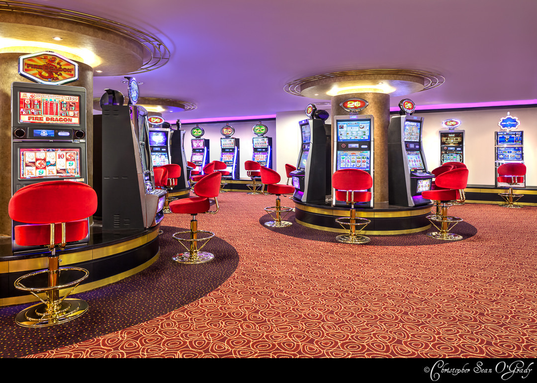 Wide interior photography showing electronic gaming machines at orchid country club singapore