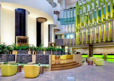 hotel lobby in singapore with symmetrical seating and front desk