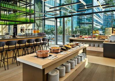 breakfast setup interior photography at yotel in singapore with fruits and fresh food