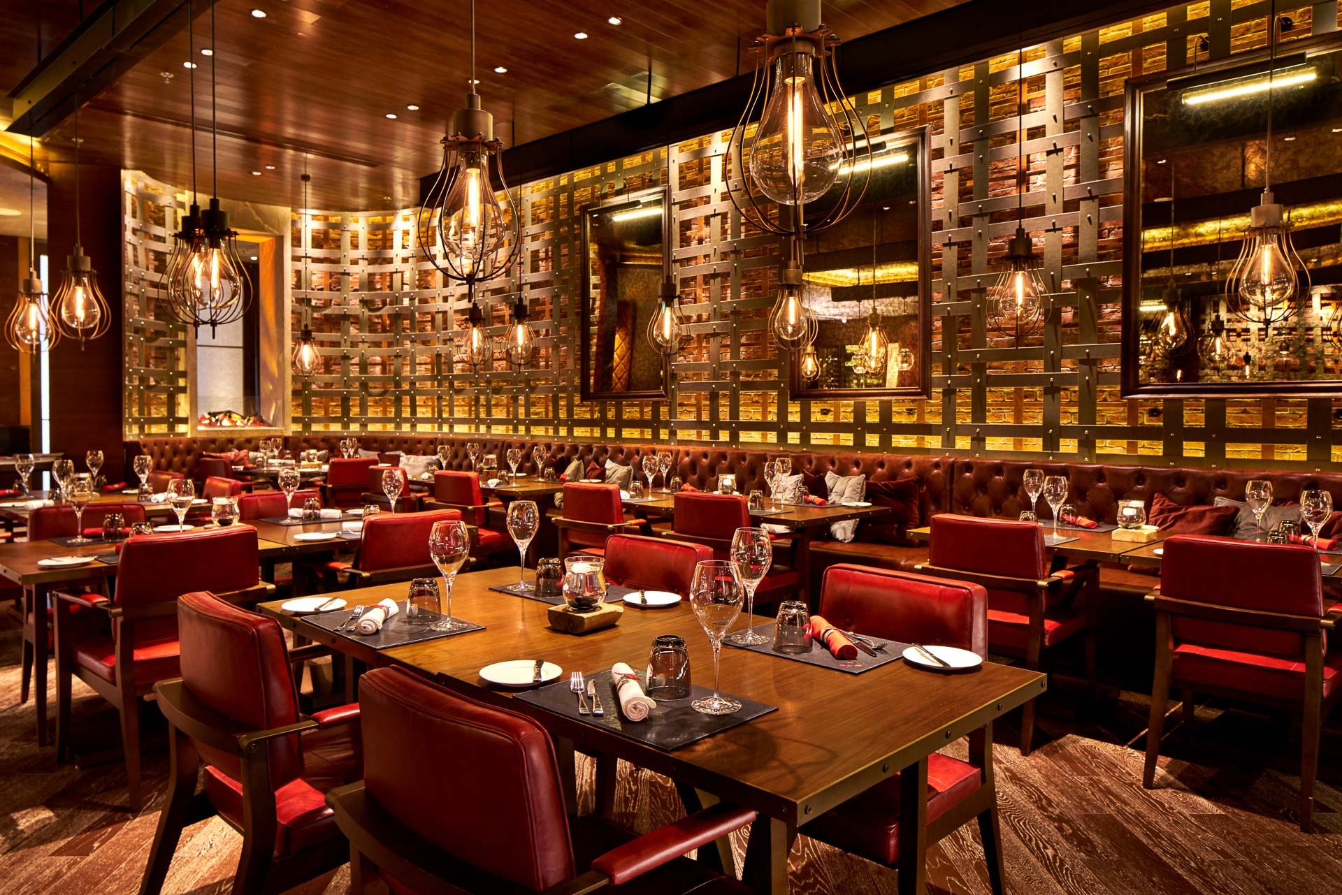 interior photography of char restaurant main room with luxury red seating in beijing china