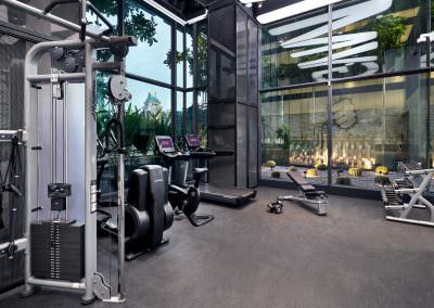 interior photography of hotel gym at yotel in singapore with weights and weight bench