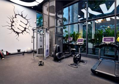 Interior photography of hotel gym at yotel in singapore with rowing machine and exercise equipment