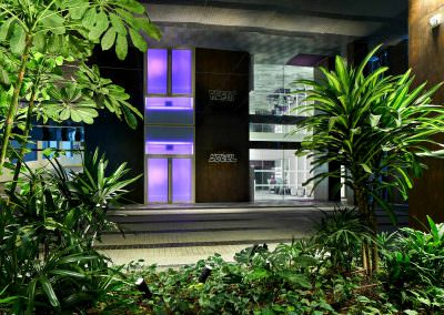 architectural photography of the hotel exterior with greenery at yotel in singapore