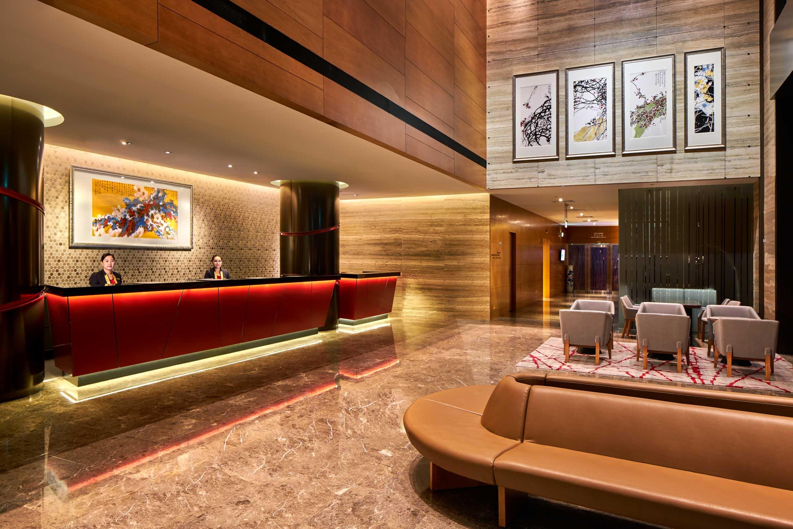 Ramada Hotel Main Lobby with staff