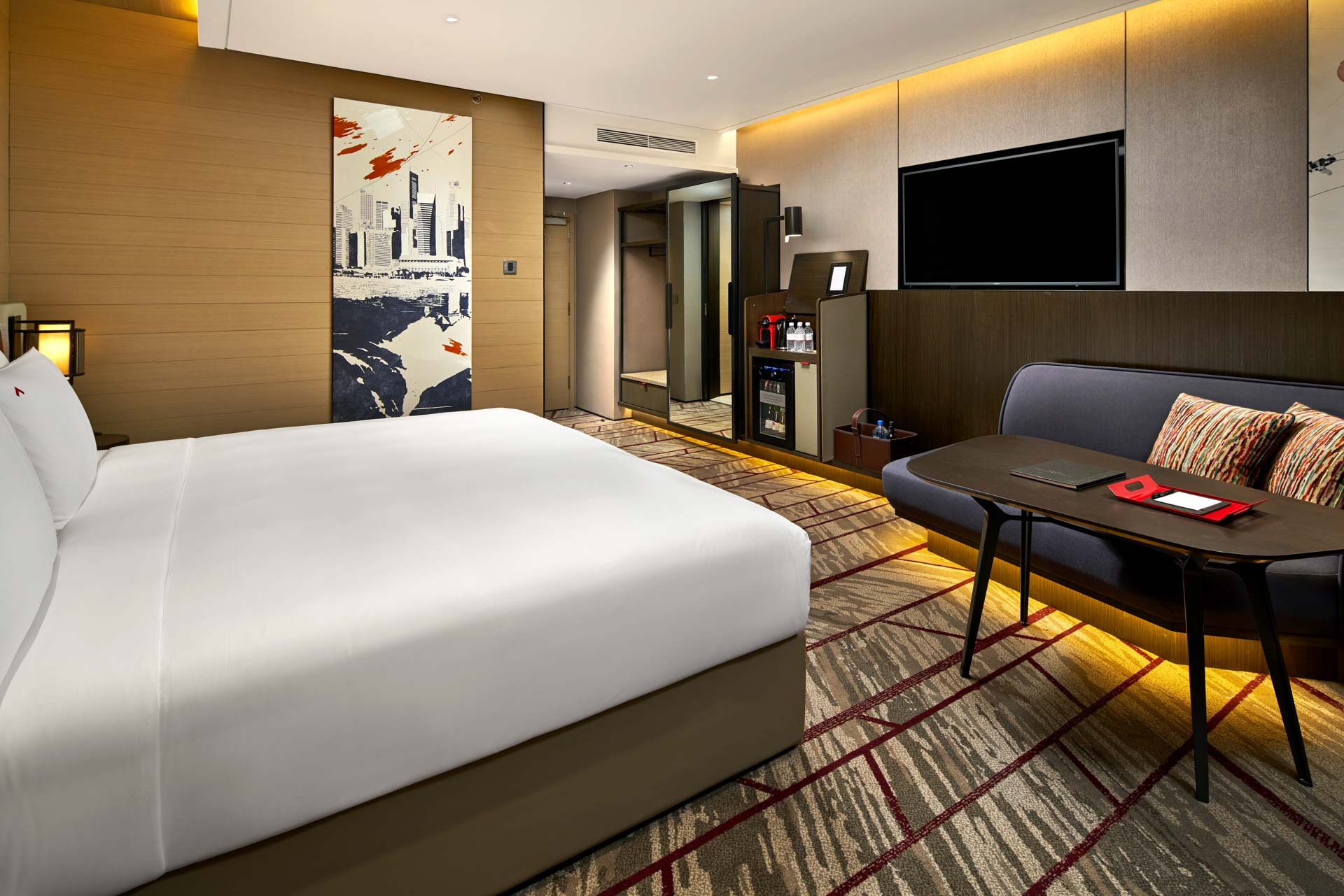 hotel photography of the king bedroom from a second angle at swissotel the stamfored in singapore
