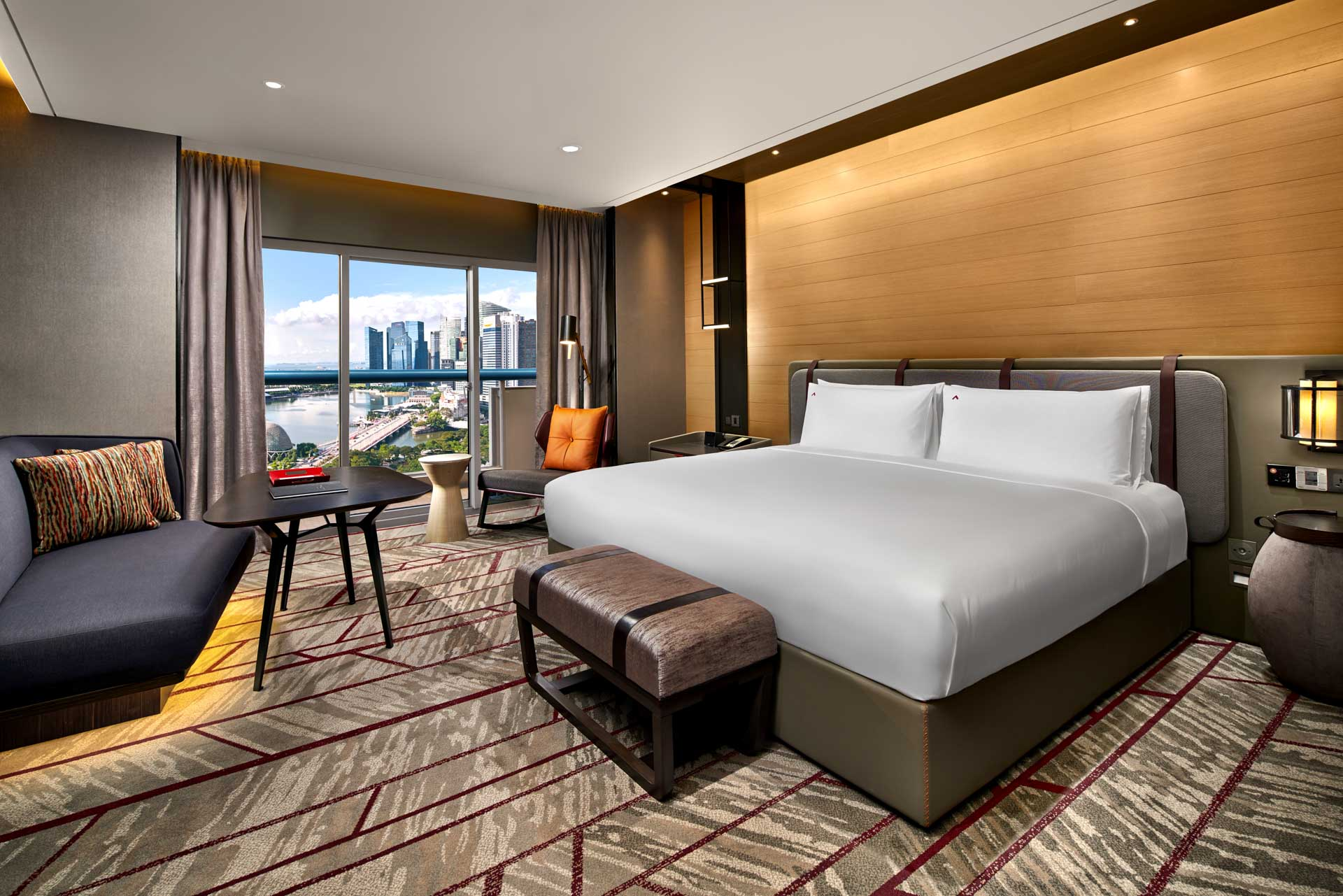 luxury hotel photography of the king room with harbour view at swissotel the stamfored in singapore