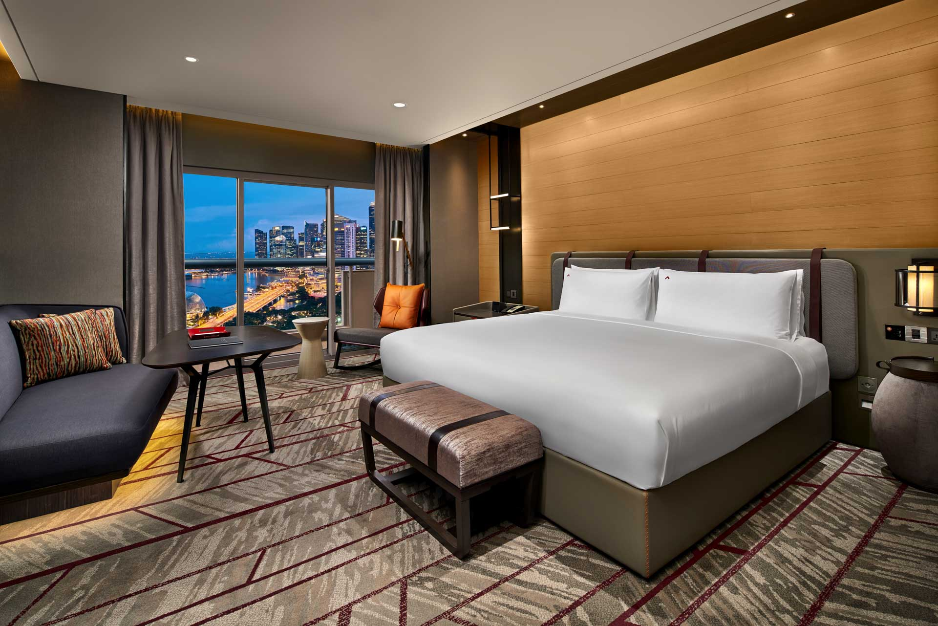 luxury hotel photography of the king bedroom at swissotel the stamfored in singapore