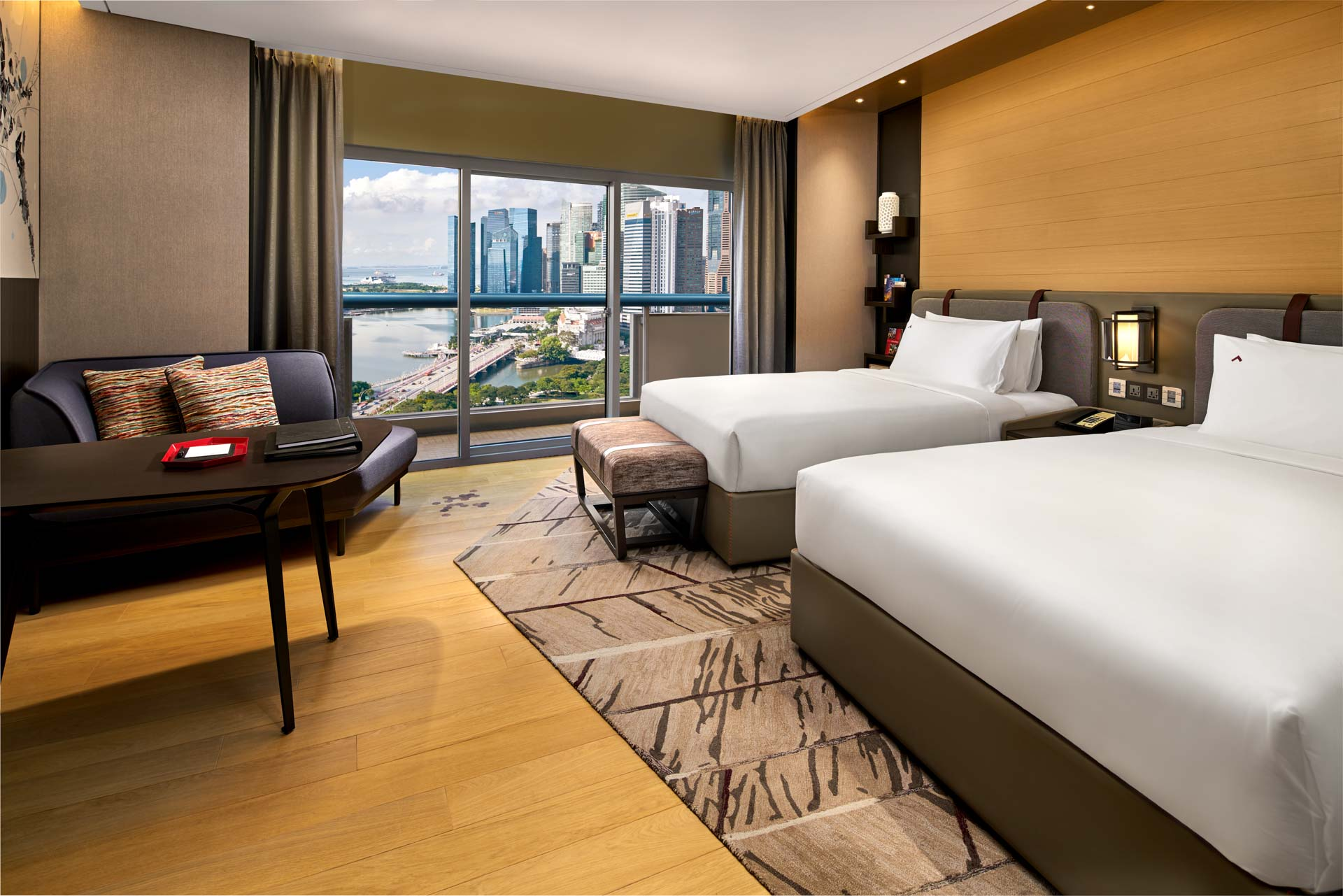 luxury hotel interior photography of the twin room with harbour view in the day at swissotel the stamfored in singapore