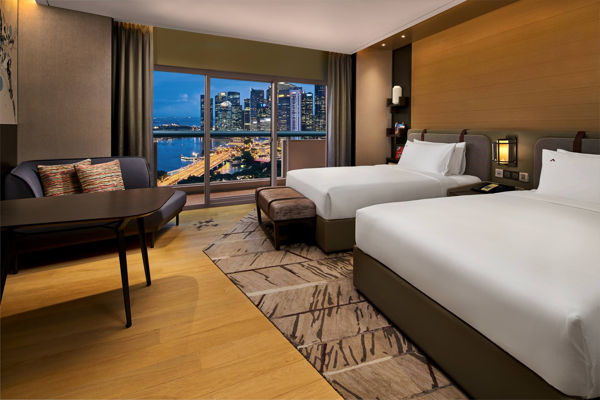 luxury hotel photography of the twin room with harbour view at swissotel the stamfored in singapore