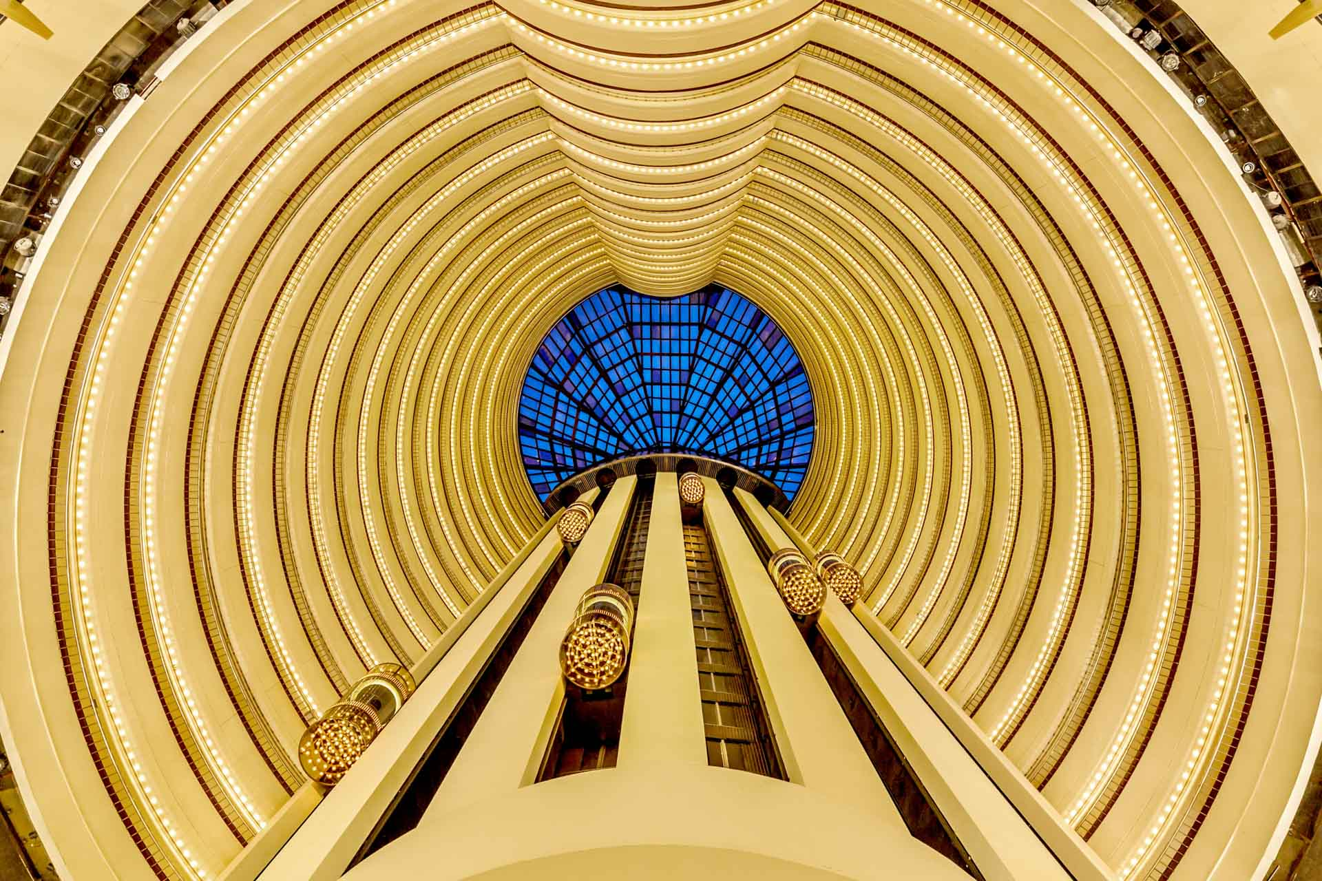 architectural photography of the hotel lobby at holiday inn atrium singapore