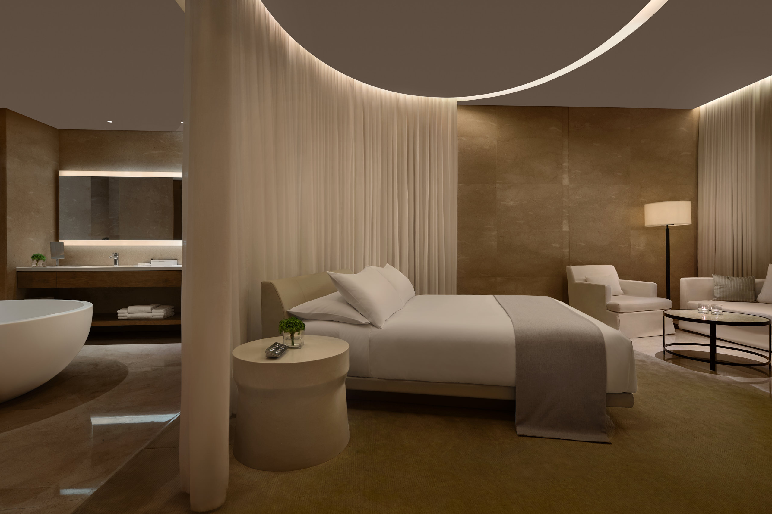 Night view of loft hotel room with romantic soft lighting. Bedroom and bathroom divided by curtain at hotel in sanya, china.