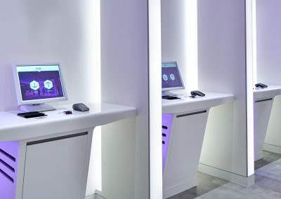 interior photography of the lobby kiosks on an angle with purple lighting