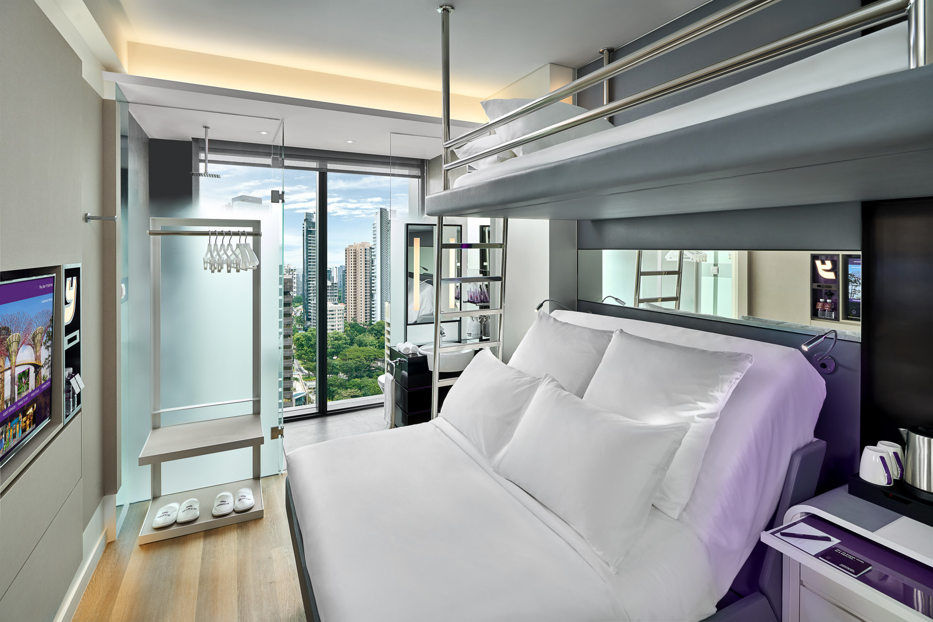 Hotel interior photography of queen bunk room with view of singapore