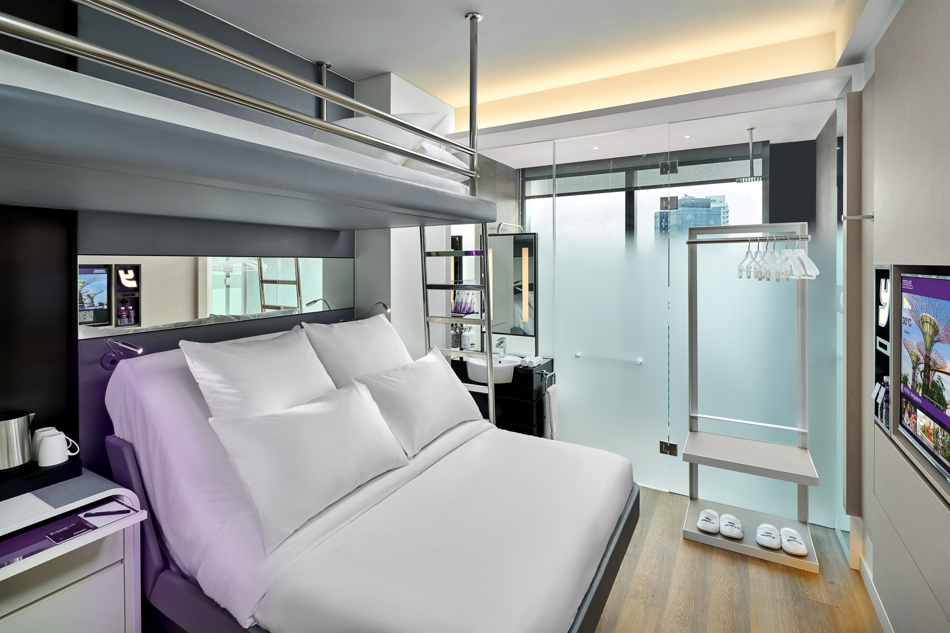Interior photography of queen bunk rooms at yotel in singapore with bunk bed and ladder
