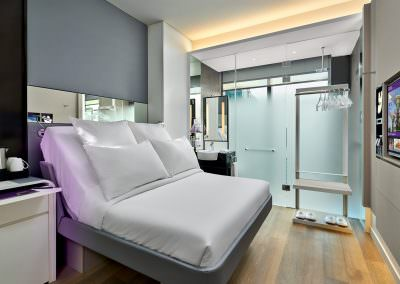 Hotel interior photography of queen bedroom at yotel in Singapore