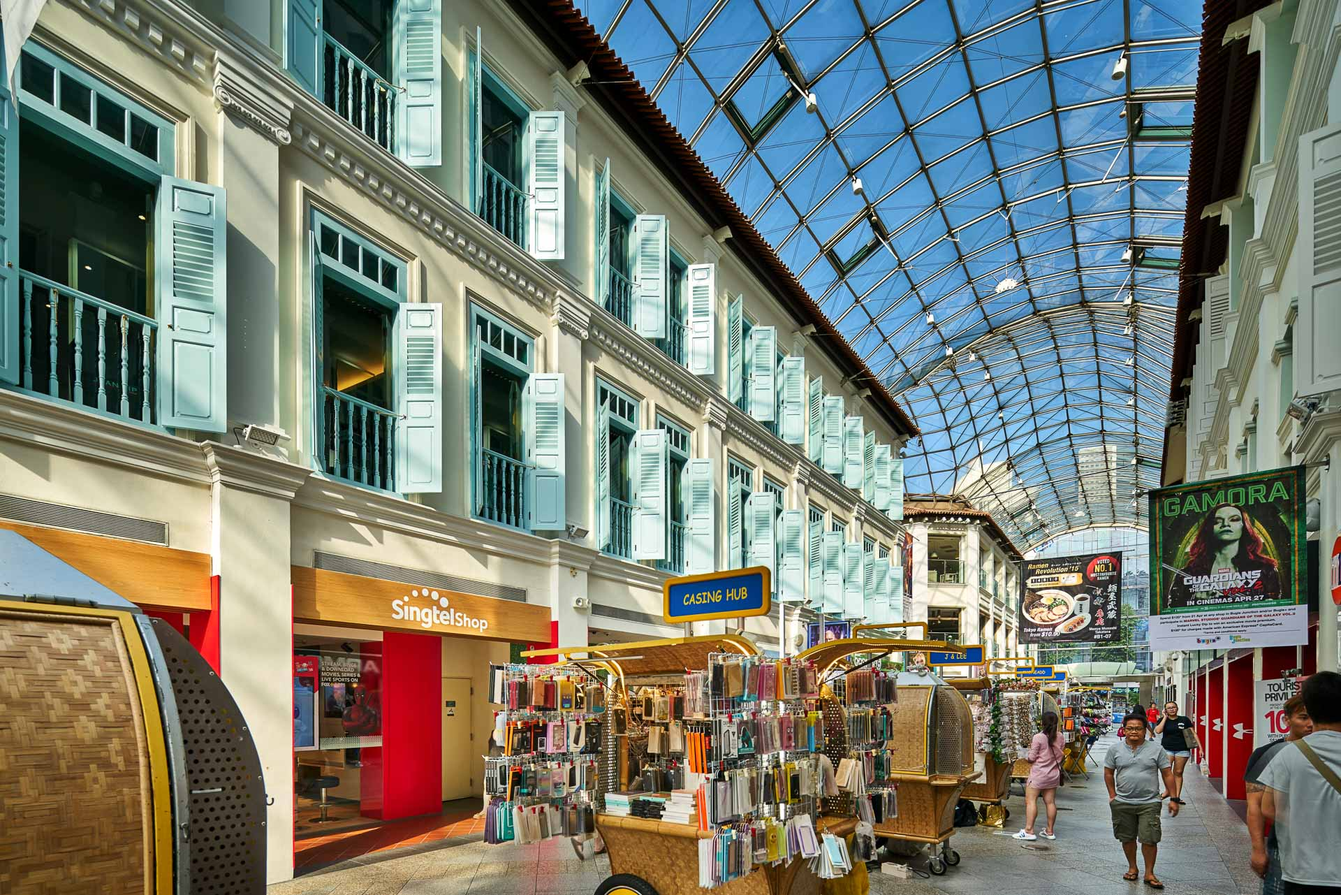 architectural photography of bugis junction mall in singapore with colourful shutters and clear sky through glass gallery ceiling