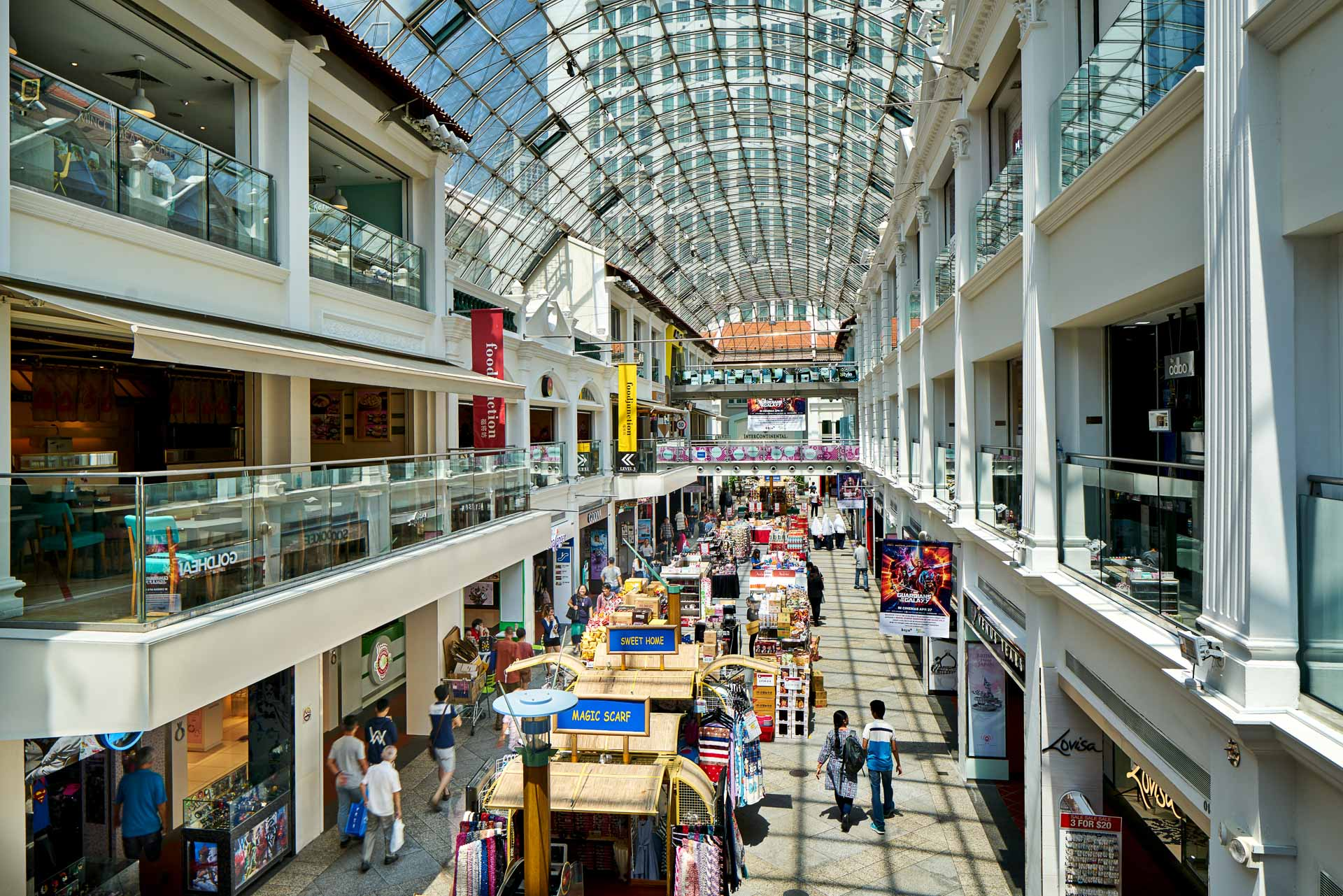 architectural photography showing long rows of shops and stalls at bugis junction mall in singapore