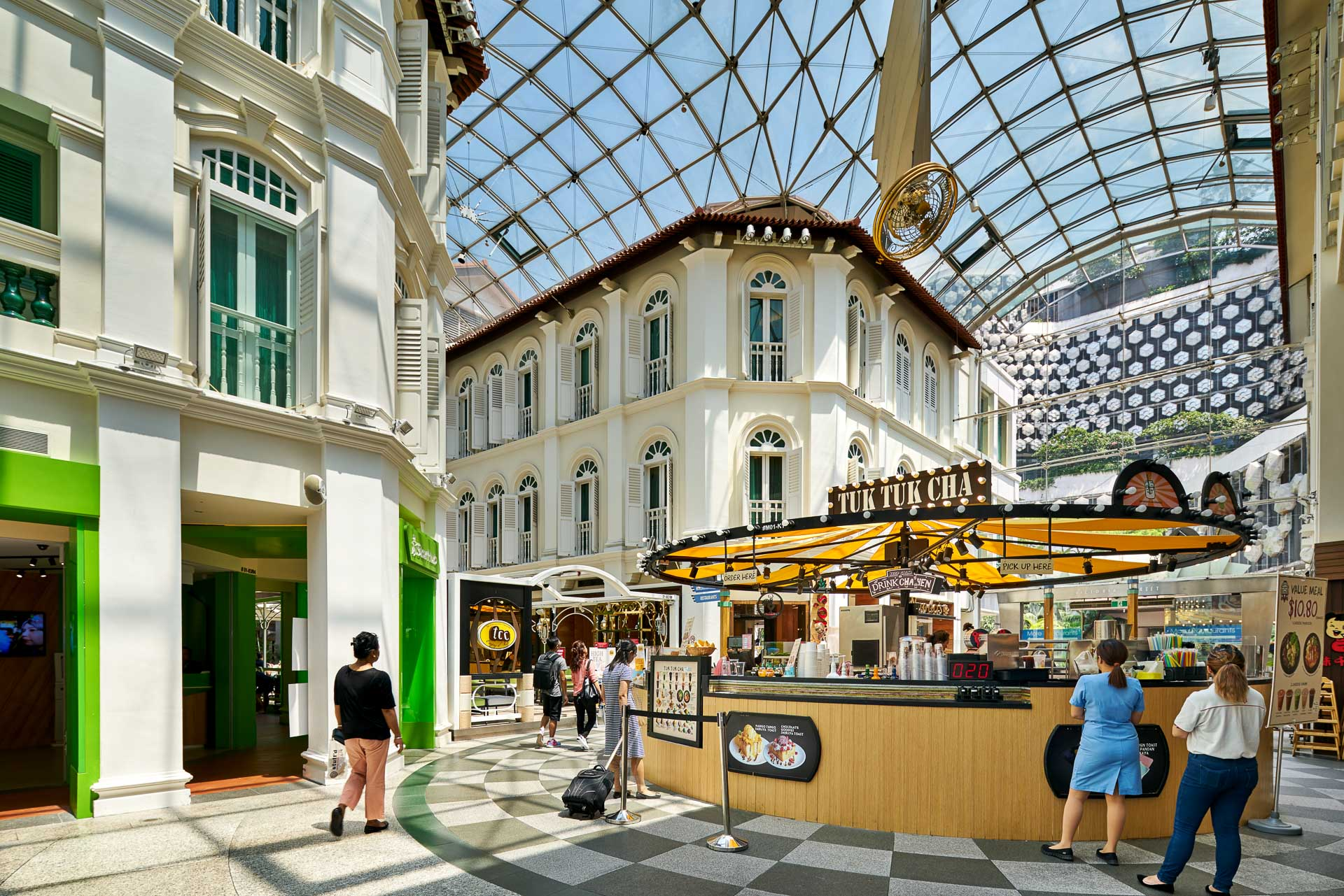 architectural photography in singapore with people ordering at ice cream shop in bugis junction mall