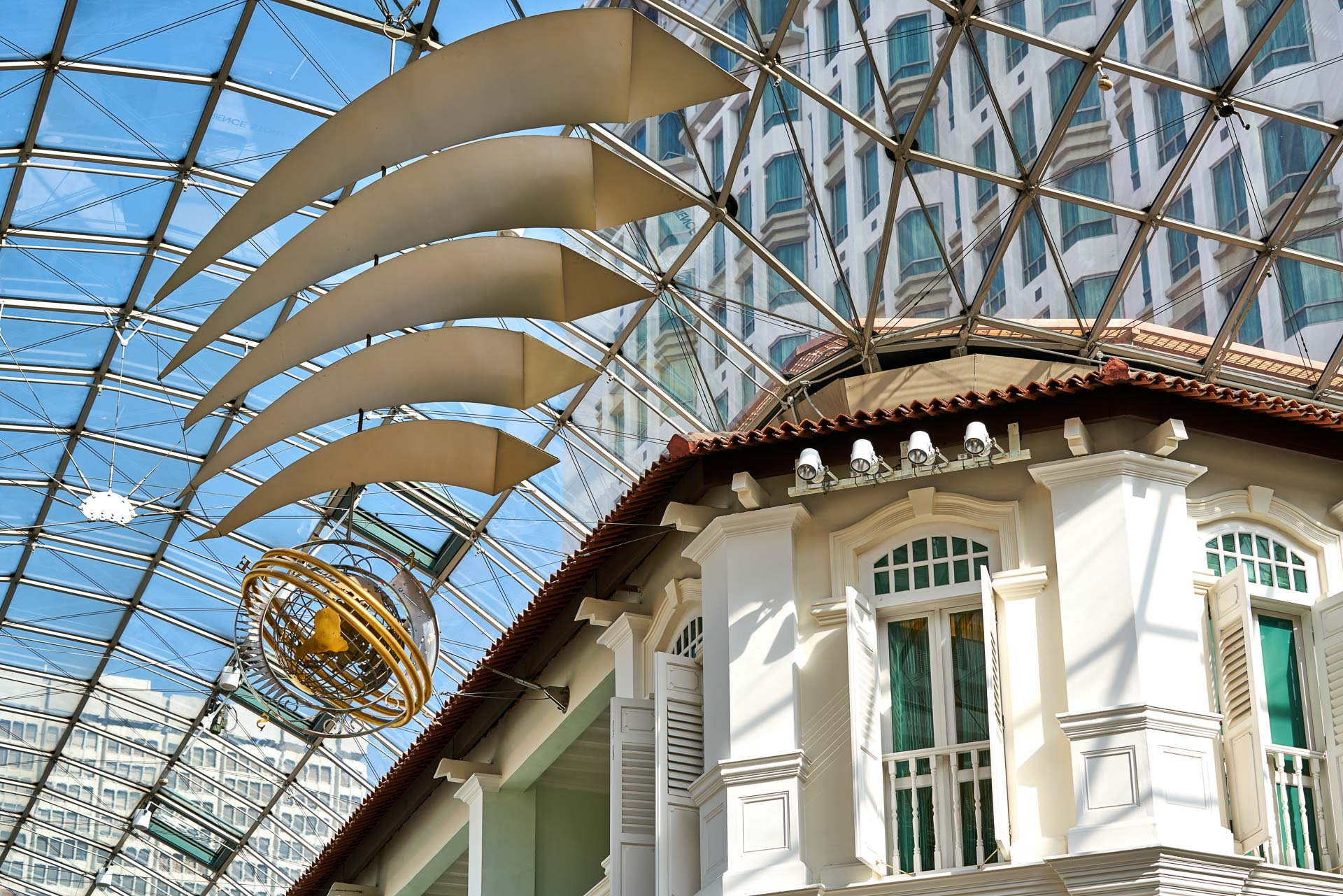 architectural photography with bugis junction hanging logo showing glass ceiling