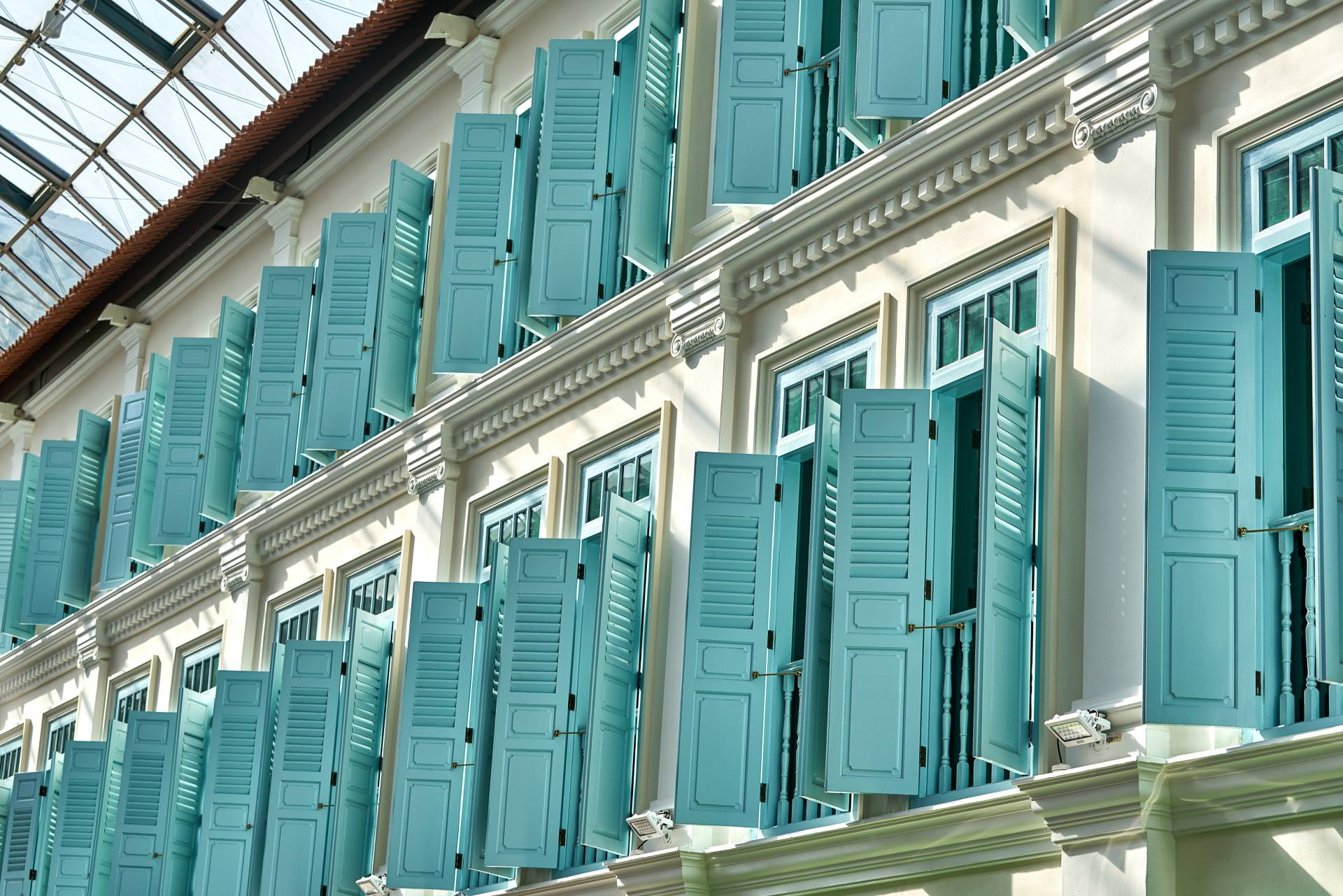 architectural photography focusing on blue shutters at bugis junction mall in singapore