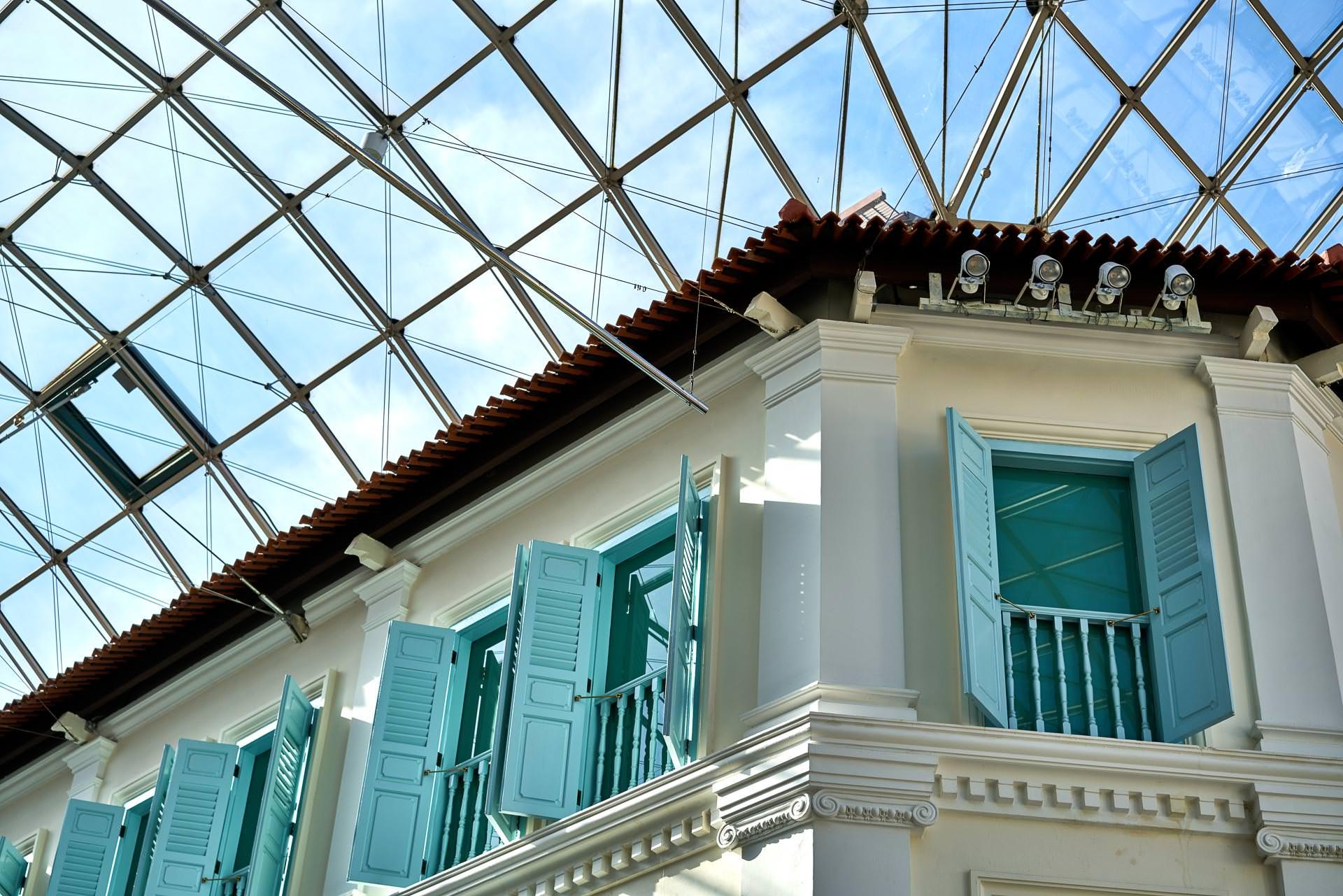 architectural photography of angle between high floors of the bugis junction mall in singapore and glass ceiling