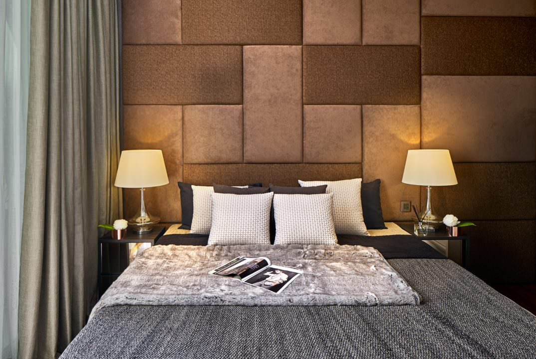 interior design photography of bedroom with pillows and magazine on bed