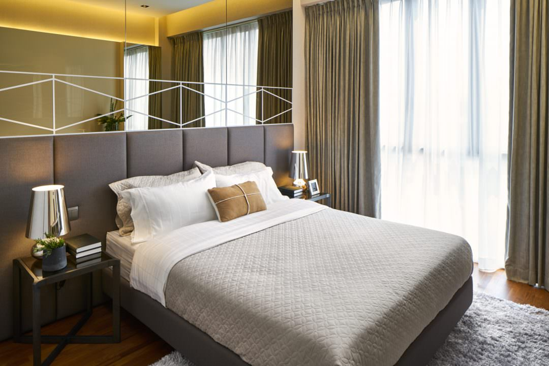 luxury bedroom with designer pillows and lamp shades