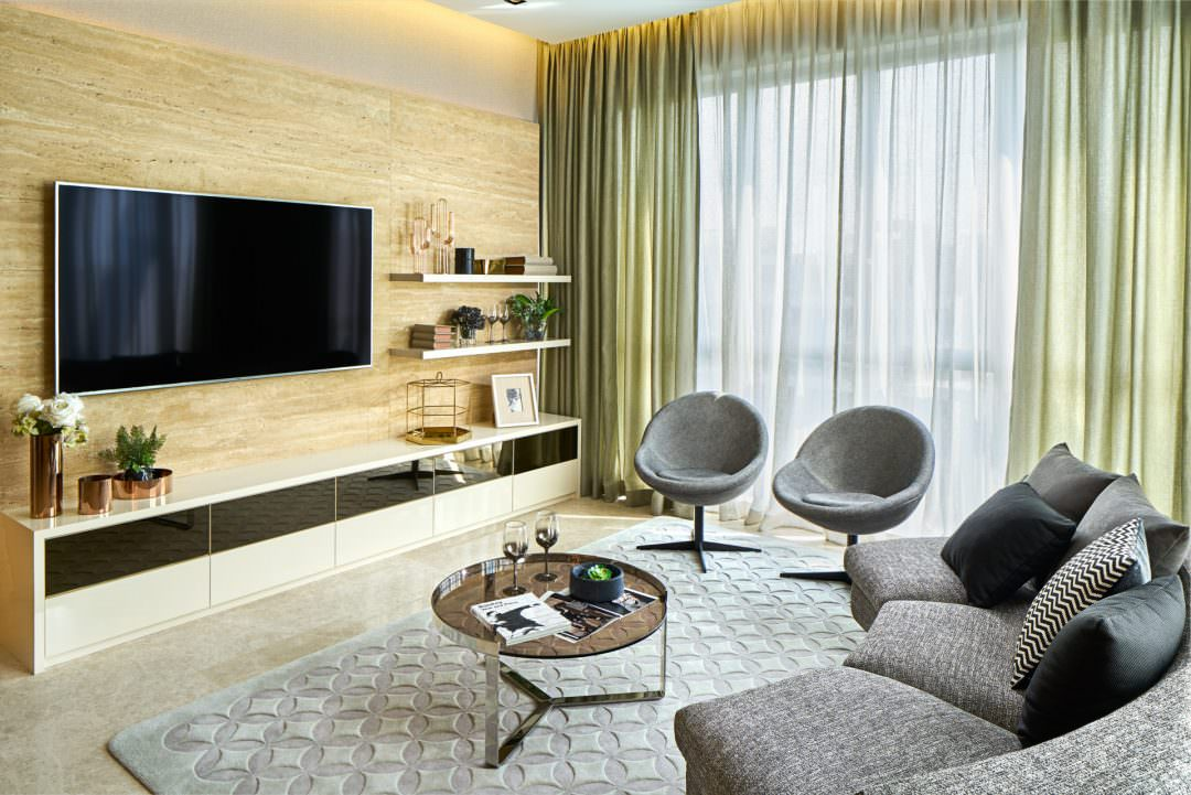 interior design photography of living area in singapore with couches and chairs looking at tv