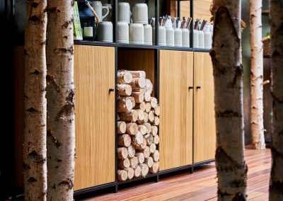Interior design detail photography of wood piles at hans im gluck restaurant in singapore