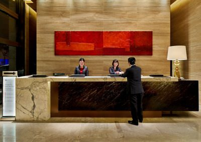 Hotel Interior Photography Hong Kong - Front Desk with Staff