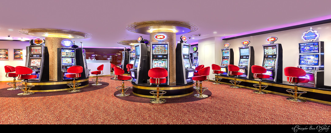 Interior Photography showing slot machines at Orchid Country Club Singaopre
