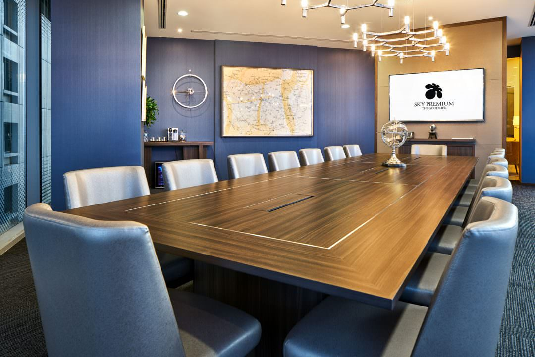 Interior Photography of the sky premium boardroom with antique map on back wall in singapore