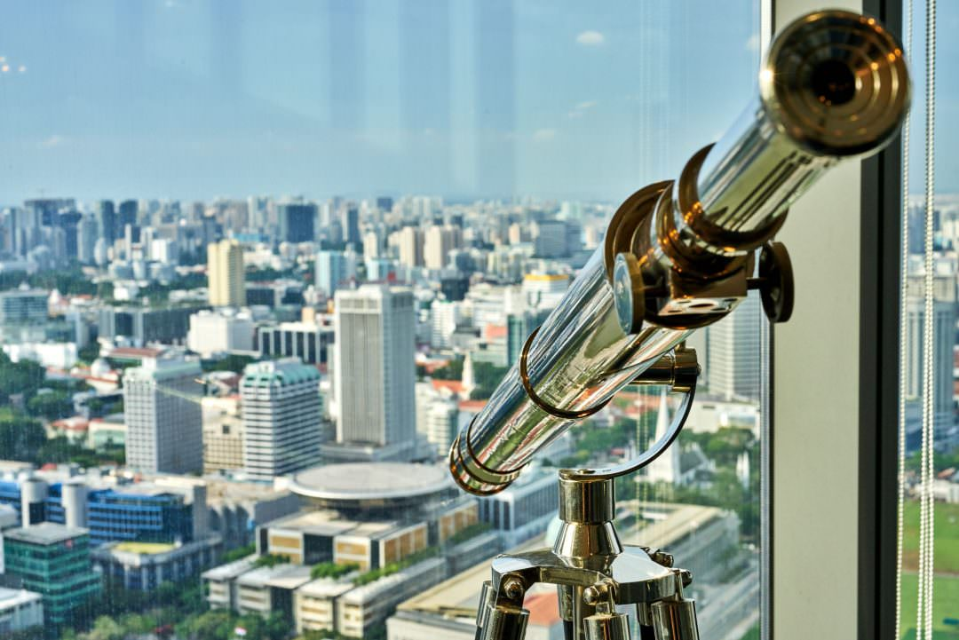 detail photo of a telescope overlooking singapore in the sky premium boardroom