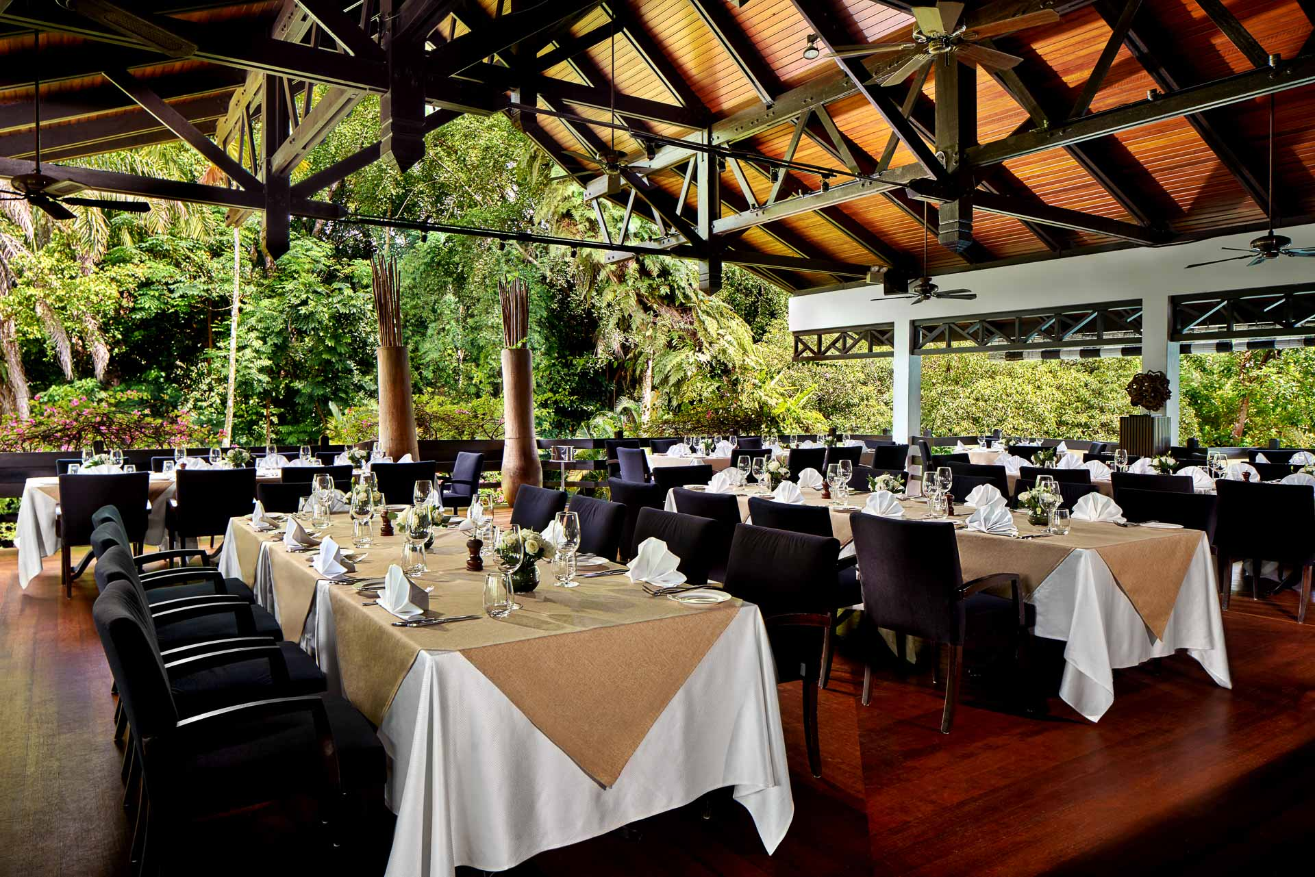 interior photography of arbenz restaurant at swiss club in singapore with open air dining