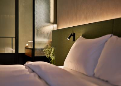 Astro Lighting Warehouse Hotel Singapore Bedroom Night Detail with bedside lamp