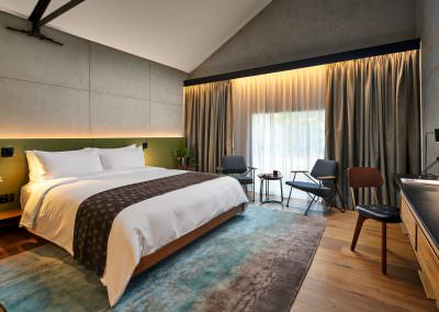 Astro Lighting Warehouse Hotel Singapore Bedroom Overview with desk and bed