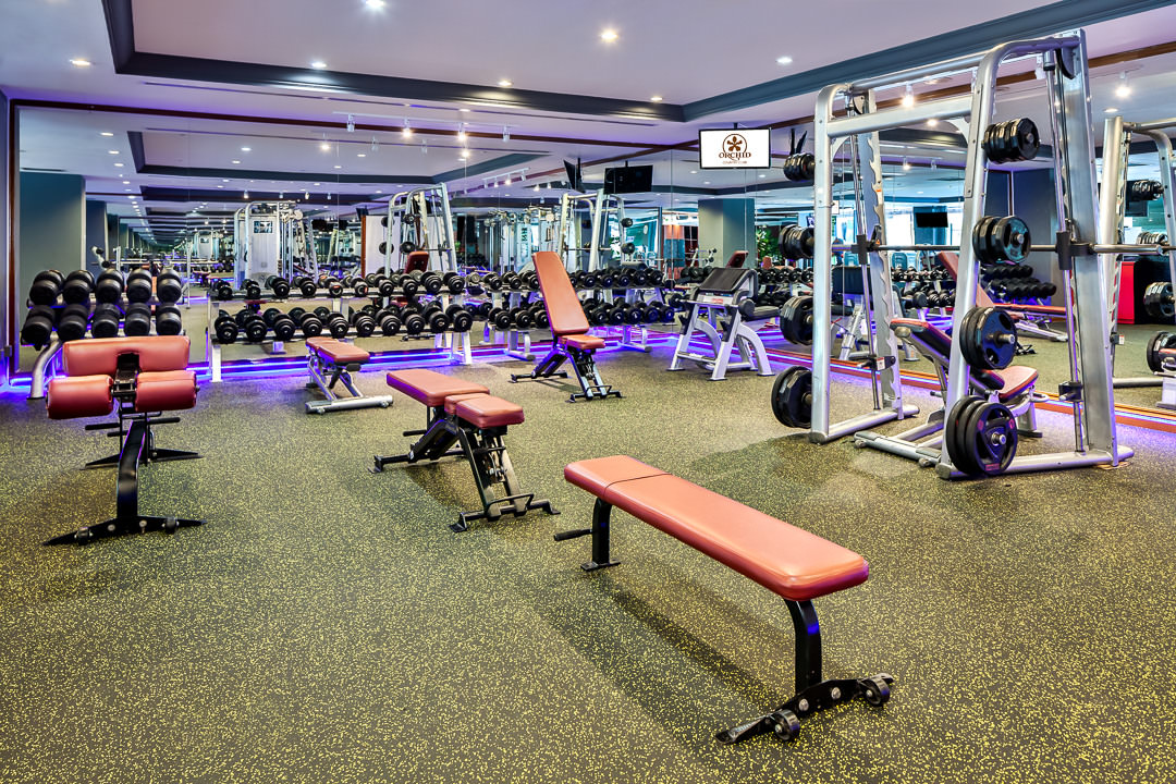 Interior Photography 1 of the Orchid Country Club Gymnasium empty to showcase workout equipment