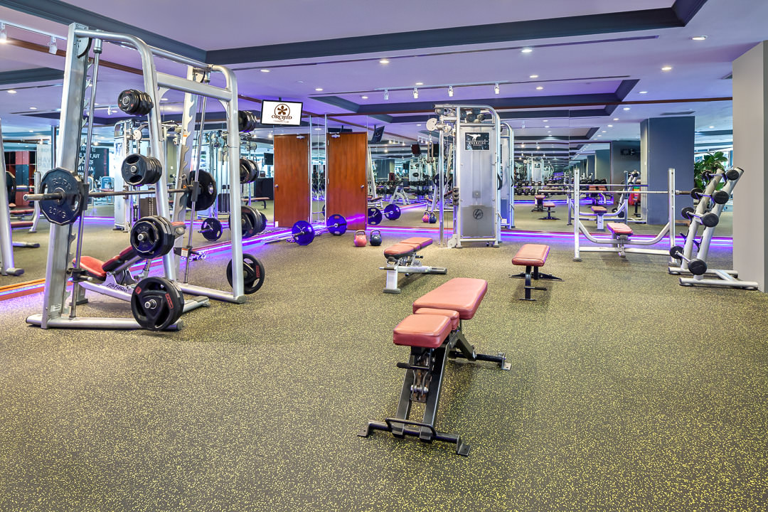 Interior Photography 2 of the Orchid Country Club Gymnasium empty to showcase workout equipment