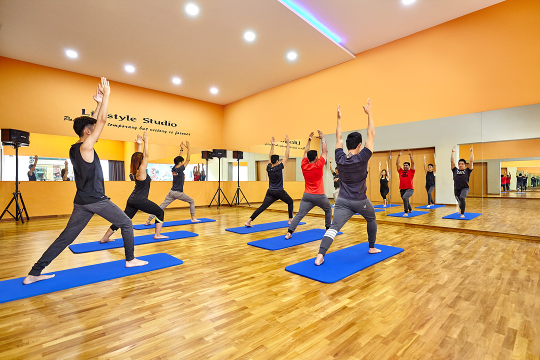 Lifestyle photography of people working out in Yoga Studio 1