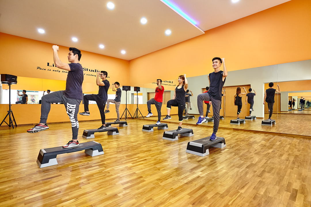 Lifestyle Photography of zumba class working out in workout studio