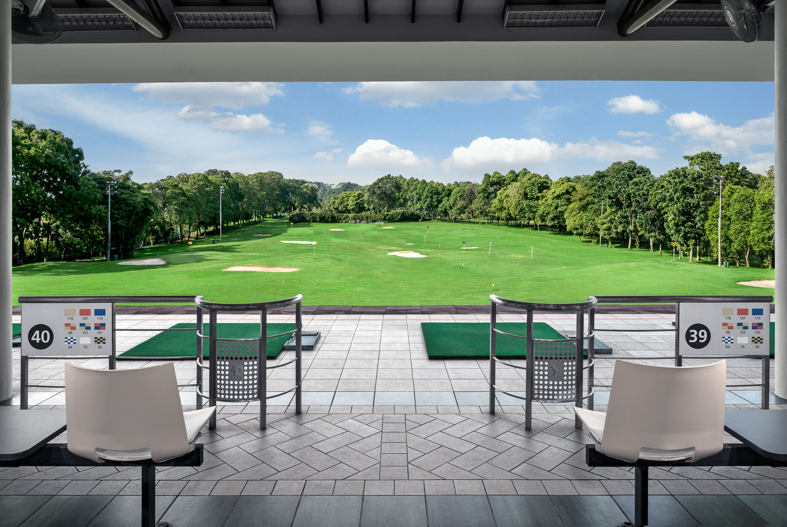 Interior photography of the seletar country club in singapore showing driving range with seats