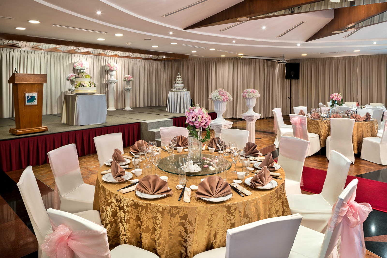 Interior photography of the seletar country club in singapore behind a wedding table setup in a ballroom
