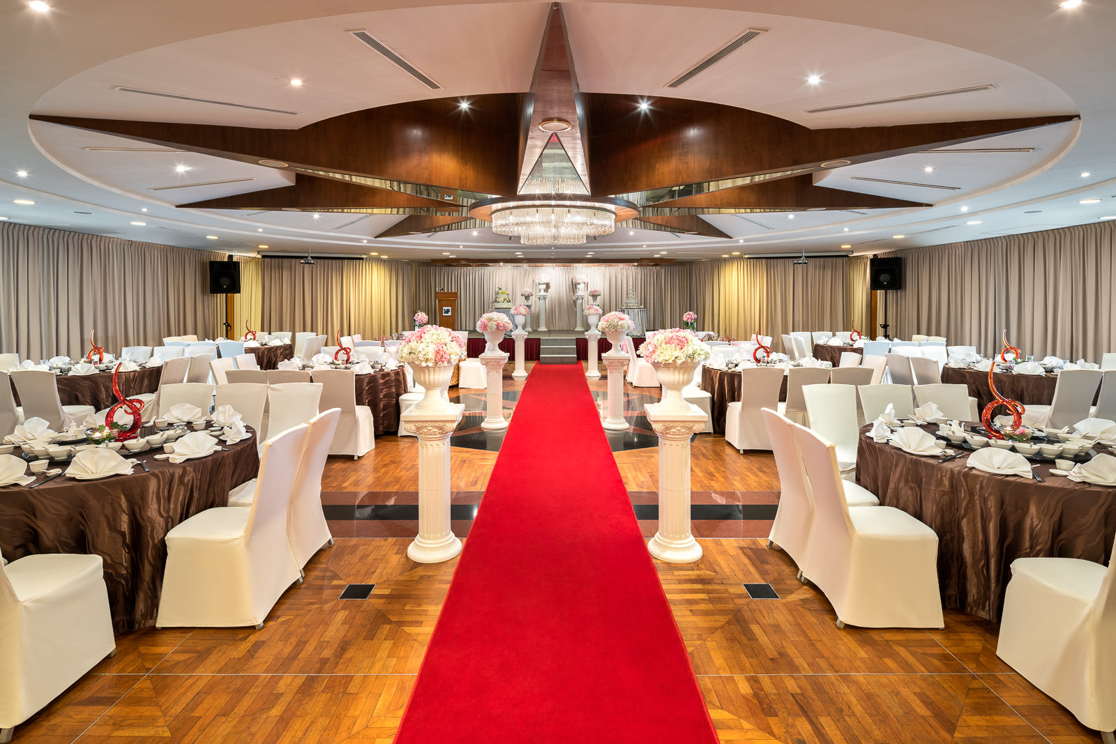 Interior photography of the seletar country club in singapore showing a wide angle photograph of the seletar ballroom wedding setup