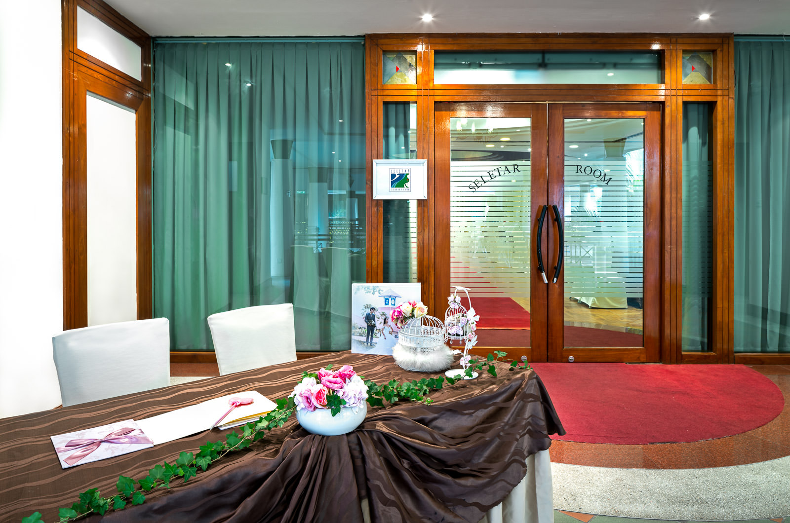 Interior photography of the seletar country club in singapore showing the entrance to the seletar ballroom for a wedding