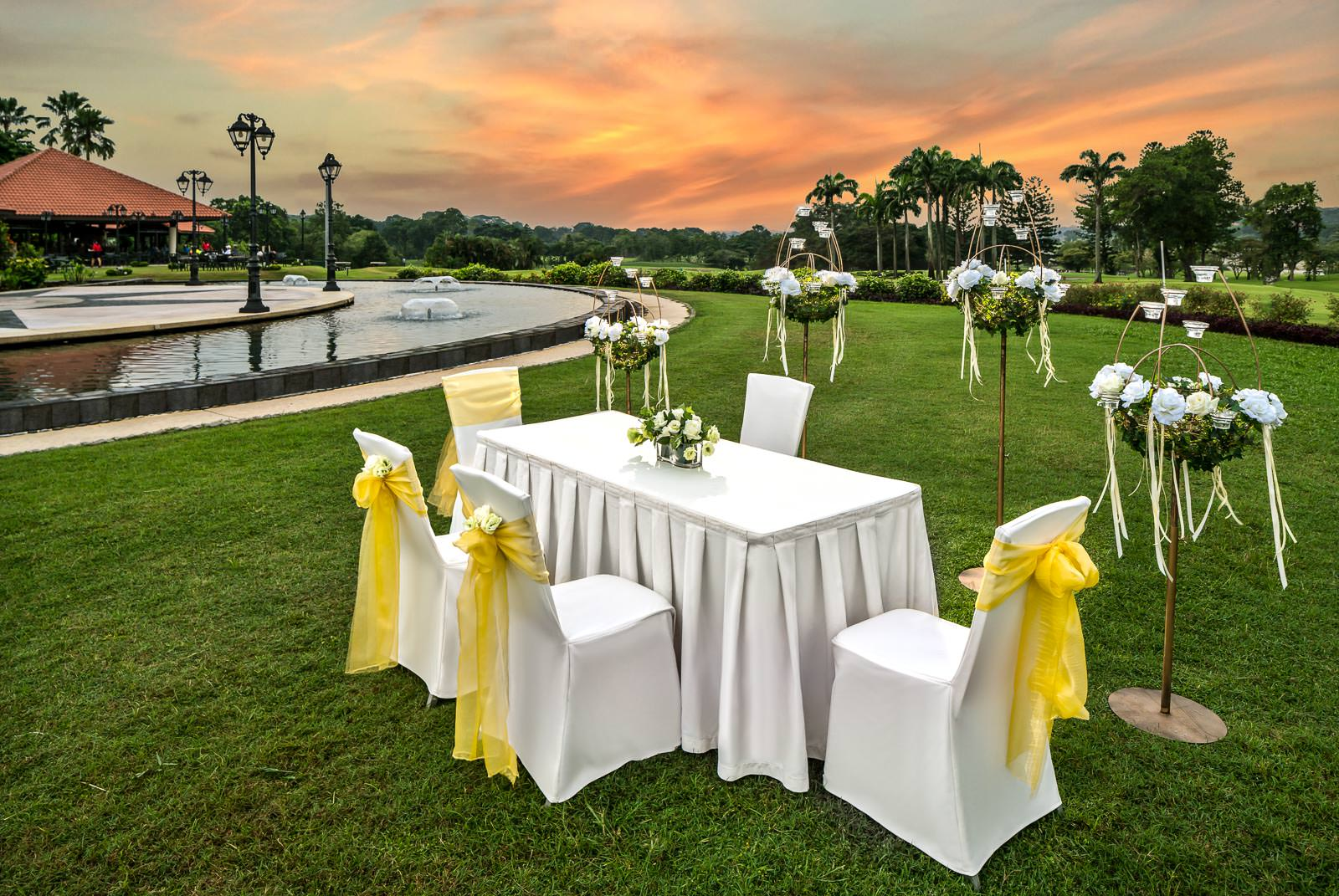 Interior photography of the seletar country club in singapore showing solemnisation table setup at dusk in Singapore