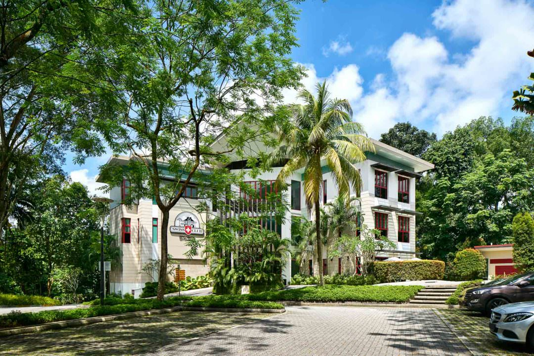 Architectural Photography of the Guesthouse at Swiss Club Singapore with trees