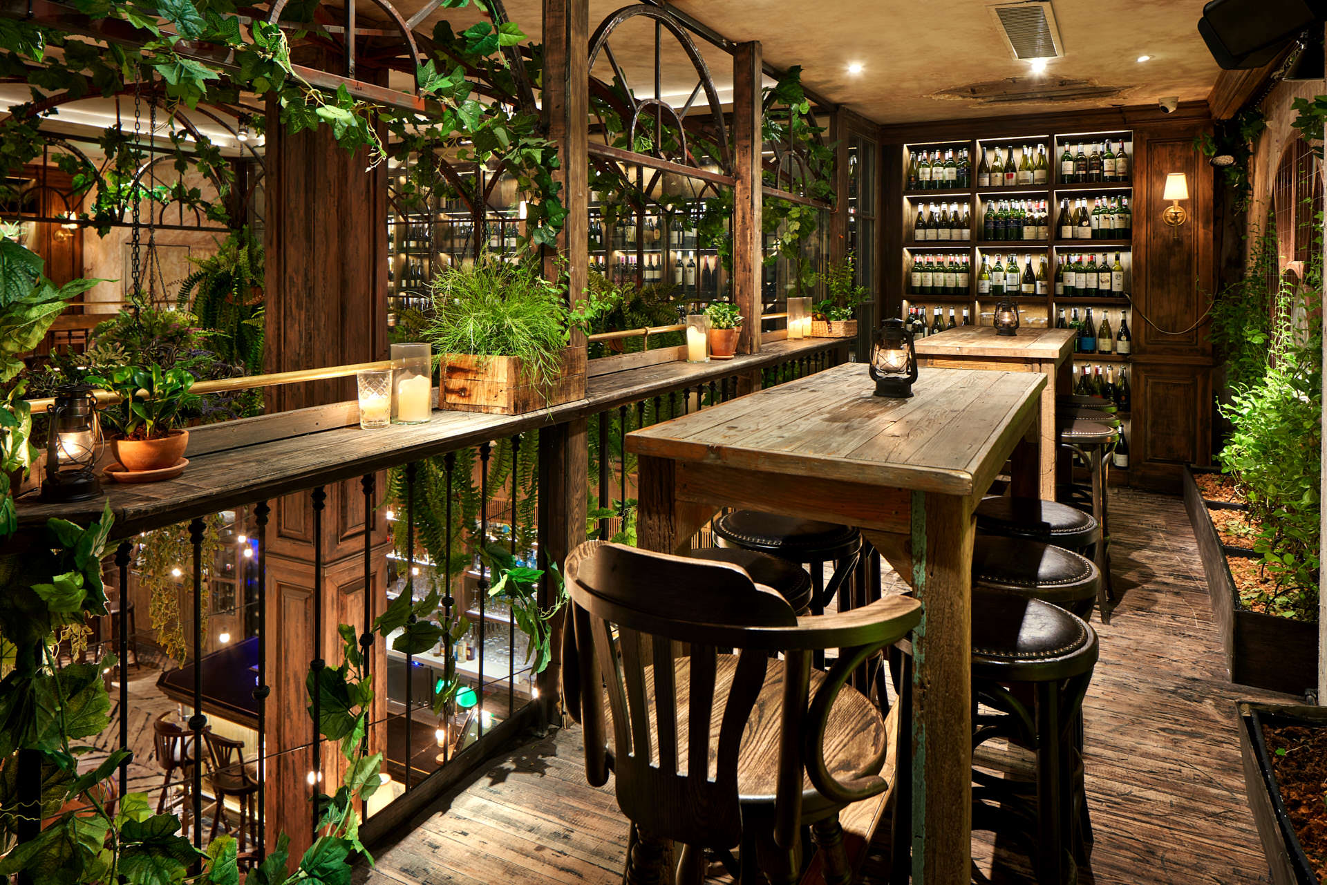 Architectural photography of the upstairs wine concourse area with vintage chairs and lanterns with candles