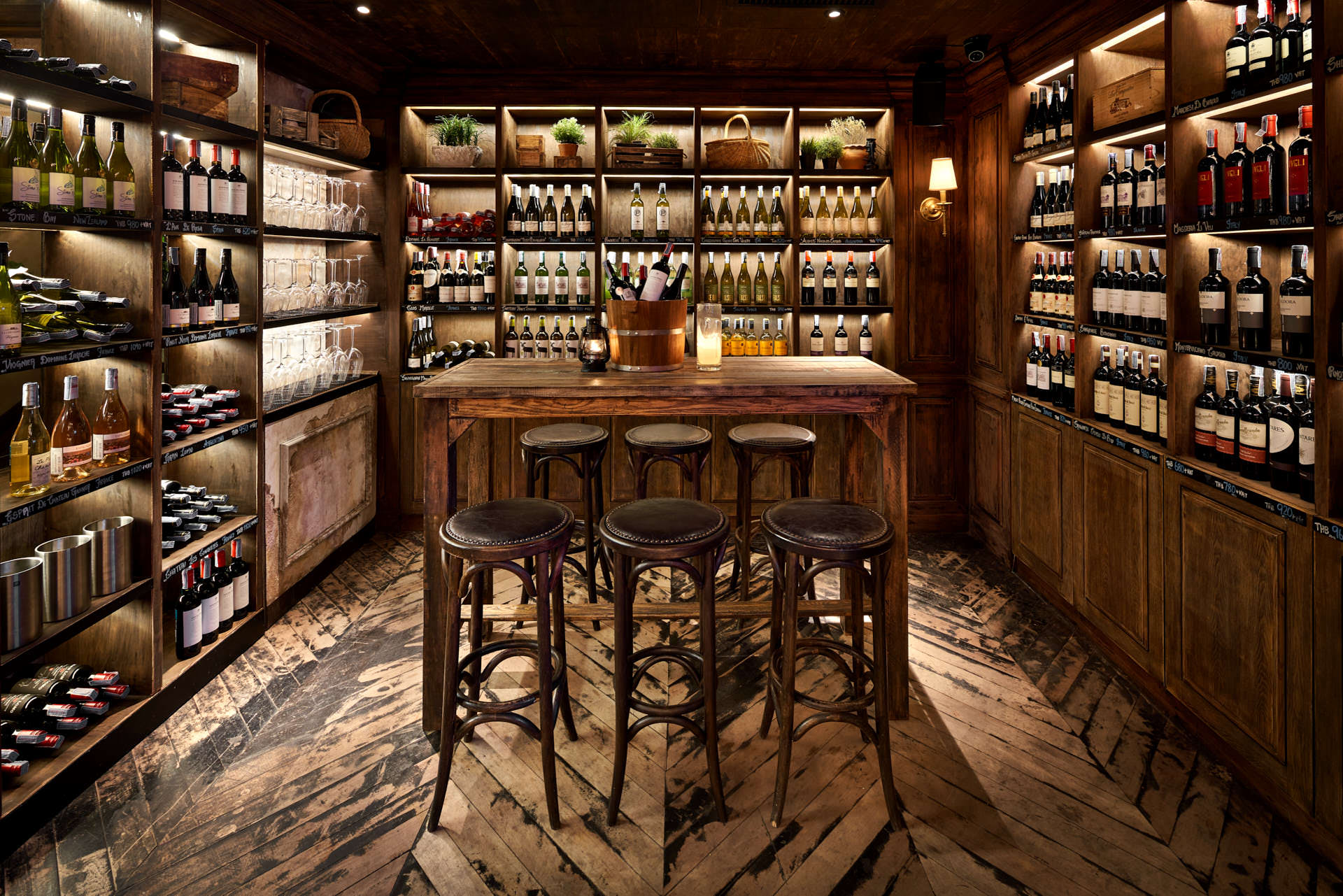 interior photography of the wine tasting area with stools and wine in a bucket