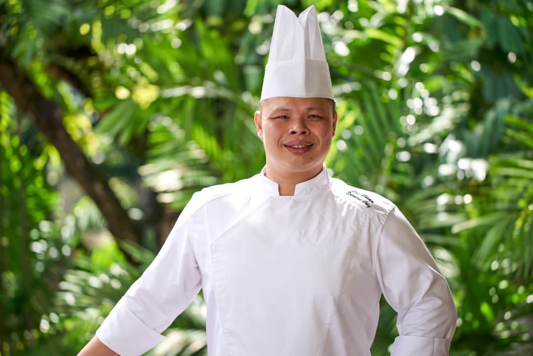 corporate portrait of head chef at tanglin club in singapore