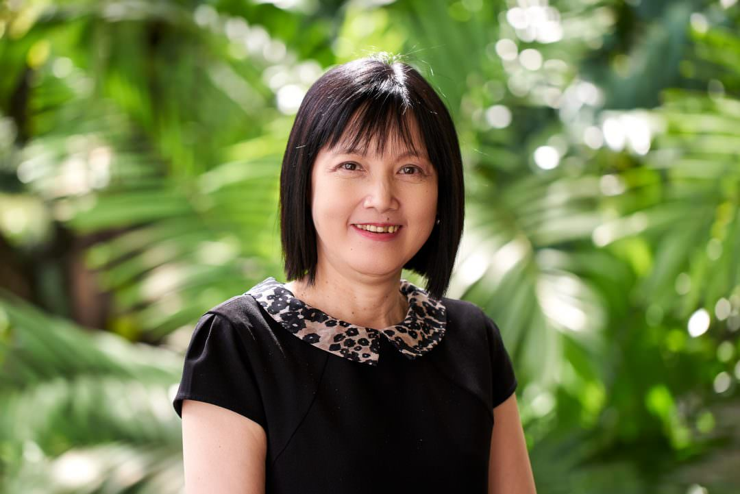 corporate portrait of asian female staff at tanglin club in singapore